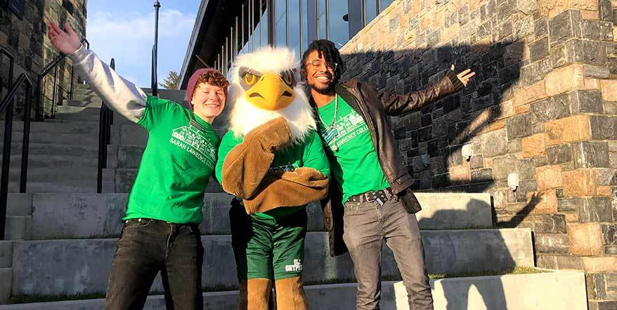 gryphon posing with student tour guides ready to welcome next SLC admitted class