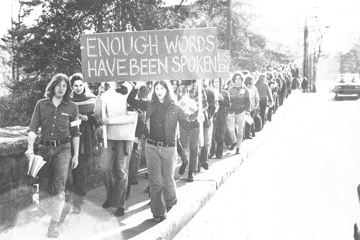 Students marching over Palmer Avenue Bridge during the Silent Peace Vigil, April 21, 1972. Photographer Unknown. (Sarah Lawrence College Archives)