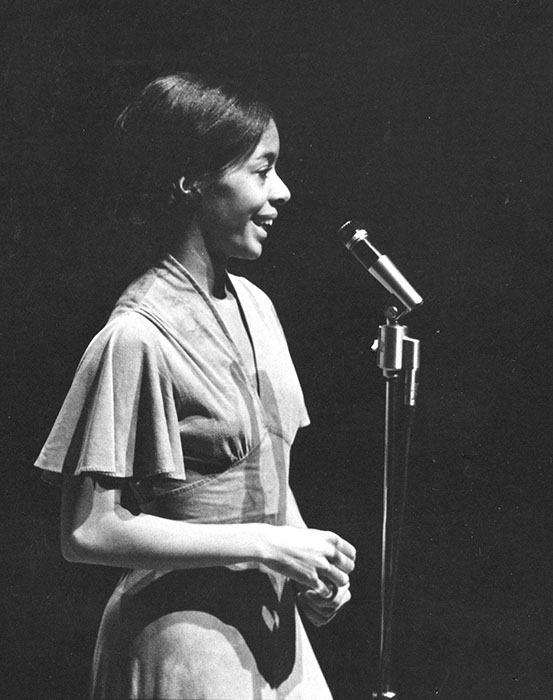 """Carolyn Adams '65 speaking at a dance performance that she choreographed in 1962 titled """"The Struggle: Two Concepts"""". Photographer Unknown. (Sarah Lawrence College Archives"""
