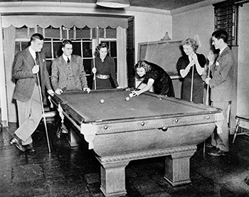 """Marjorie Rile '41, Dorothy """"Dot"""" Hodge '41, and Jo Hill '41 play pool with their dates during a Sunday tea dance. Sarah Lawrence College Yearbook 1938-1939."""
