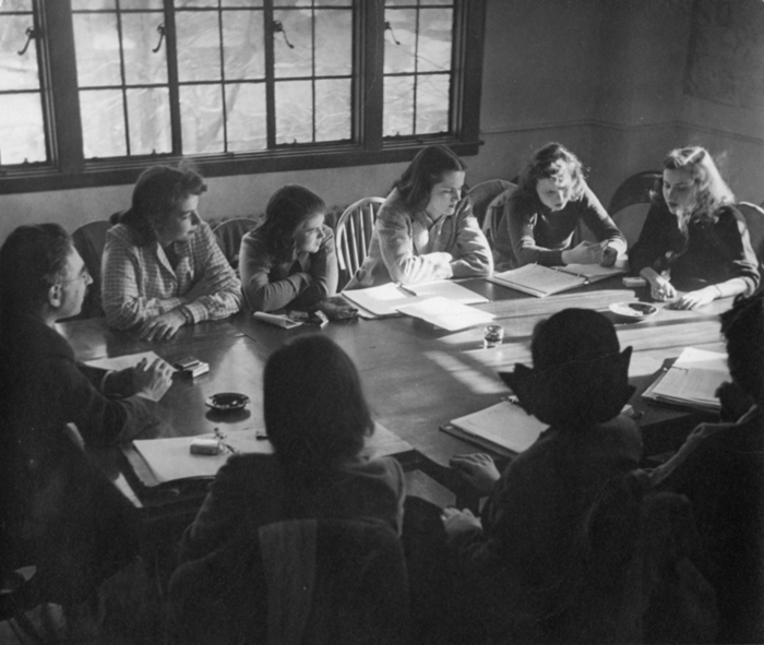 Professor Bert Loewenberg's seminar, the typical Sarah Lawrence class, in the 1940s. Photographer unknown. Copyright Sarah Lawrence College Archives.