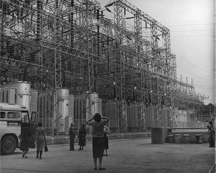 Visit to a plant during the 1955 trip. Photographer unknown.