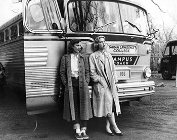 Beryl Forbes Eddy '58 (left) and Mary Elizabeth Sellers '58 wait outside the bus during the 1955 trip. (Sarah Lawrence College Archives)