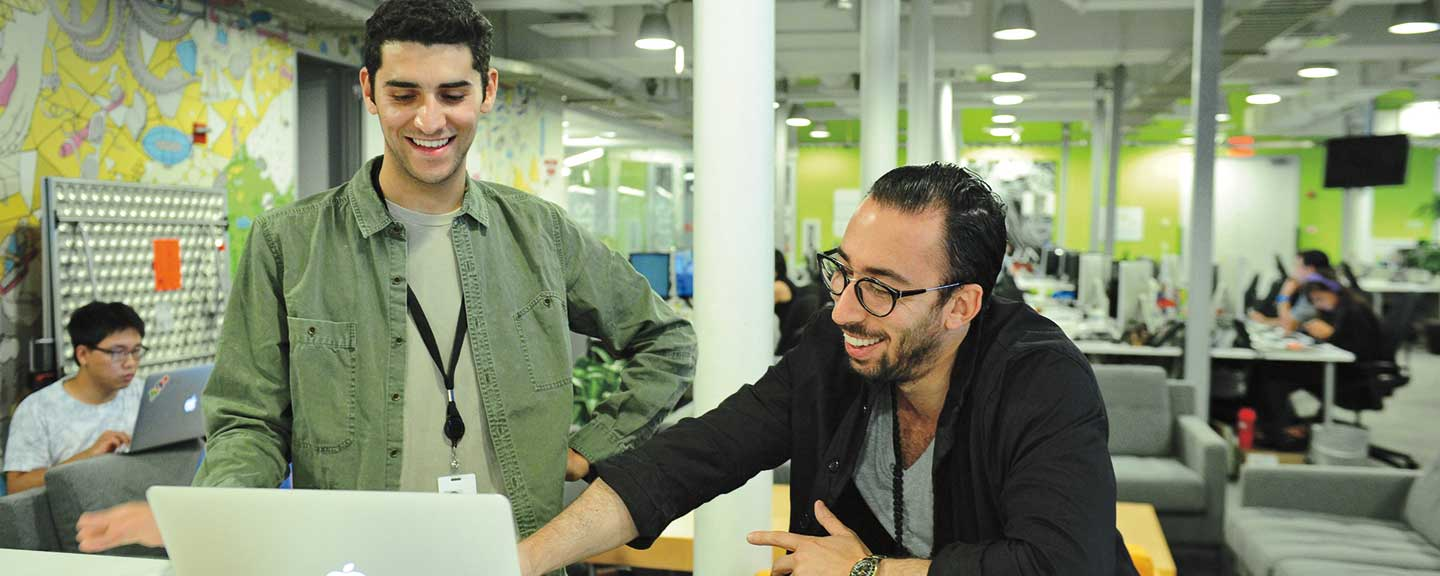 A student in conversation with an employer at his internship