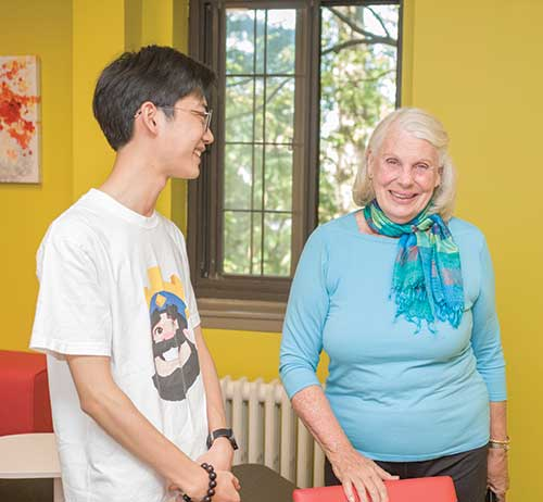 Vicki Ford visits with a student in OSilas