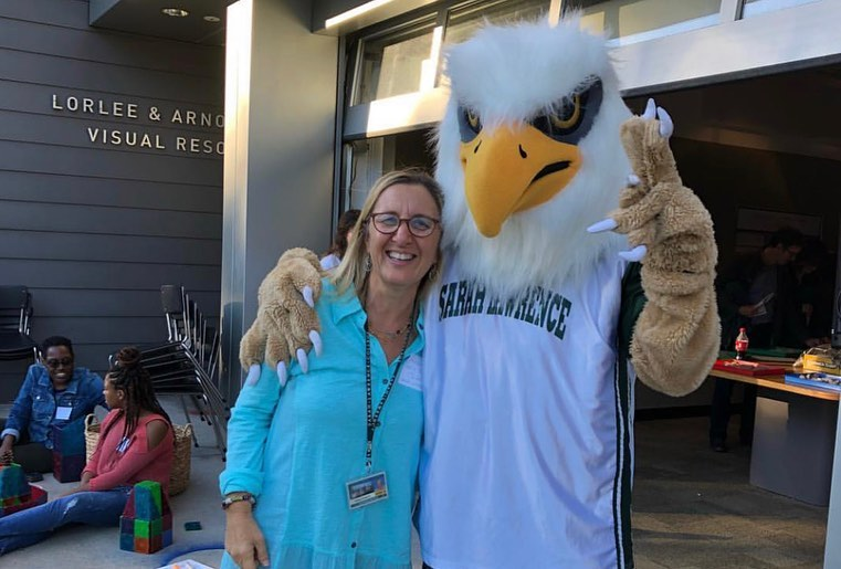 Photo of Gryphon mascot with Lorayne Carbon, director of the Early Childhood Center