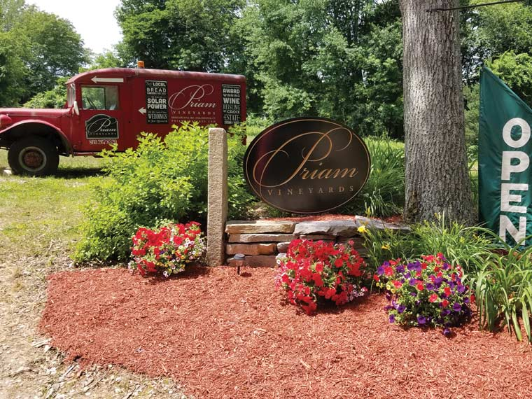 Photo of entrance to vineyard, showing sign that reads, Priam Vineyards