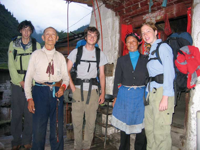 Samuel Stein '05, William Rhodes '07, and Klinger getting to know their hosts on a research trip with Muldavin in ethnically Tibetan Deqin County near the Meili Glacier