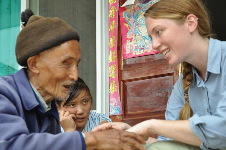 Klinger talking with a blinded former leader of Longyang Township in Yunnan Province