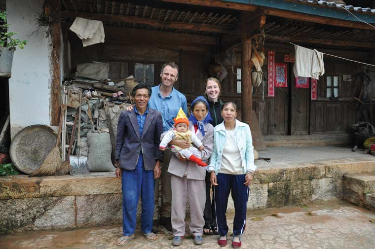 Klinger and Muldavin posing for a snapshot with a Pingzhan family they interviewed multiple times
