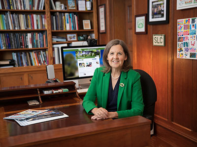 Photo of Cristle Collins Judd at her desk