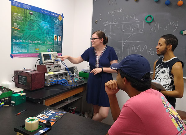 Physics faculty member Merideth Frey with students