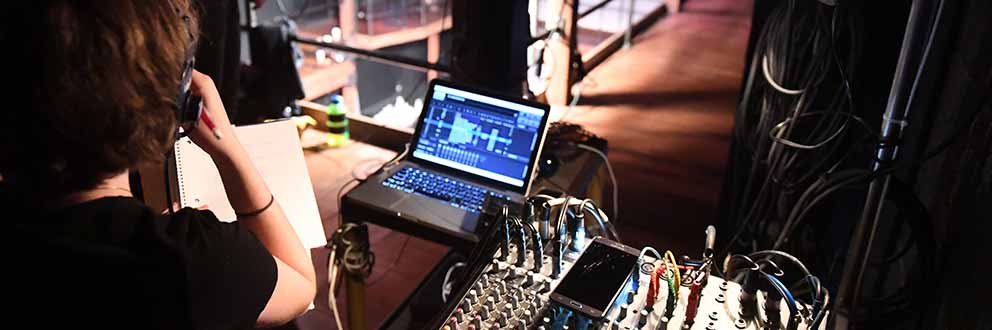 Student sitting stage lighting console