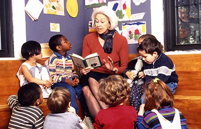 Photo of Sara Wilford reading to children