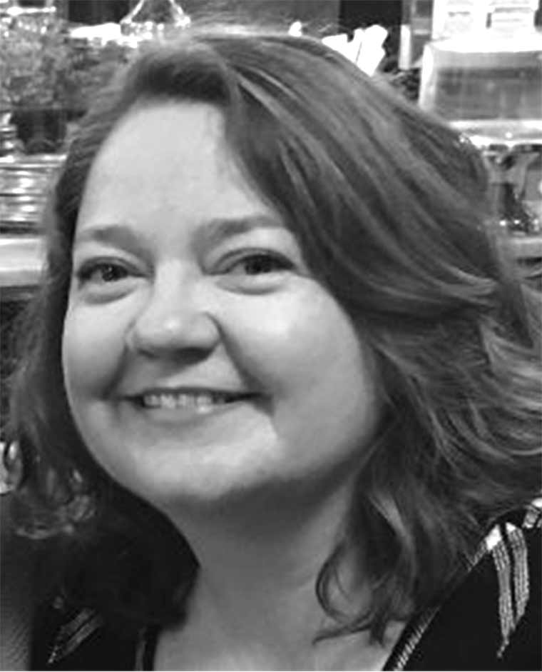 Headshot-style photograph of Susan Hawk