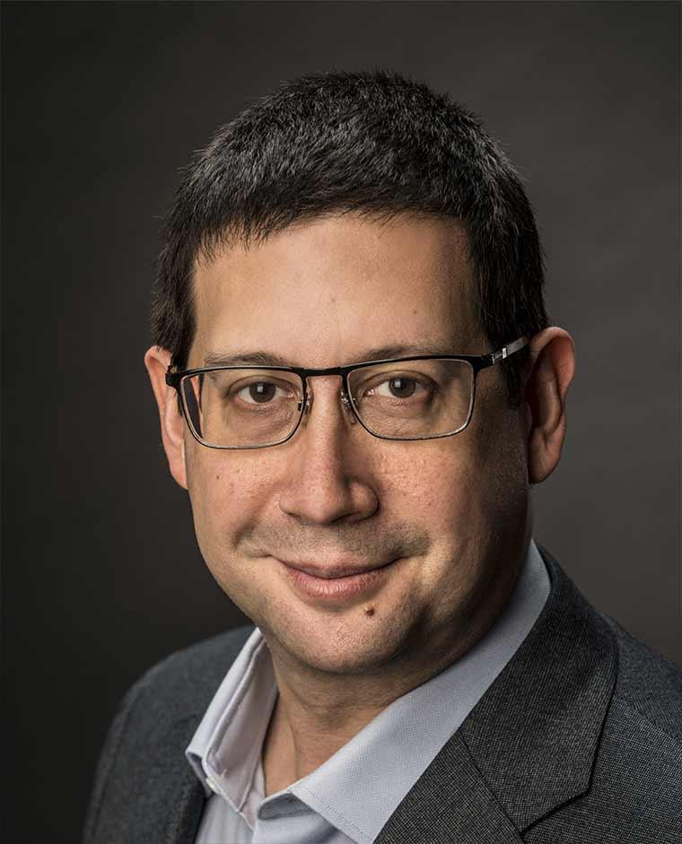 Headshot-style image of Mitch Hoffman.