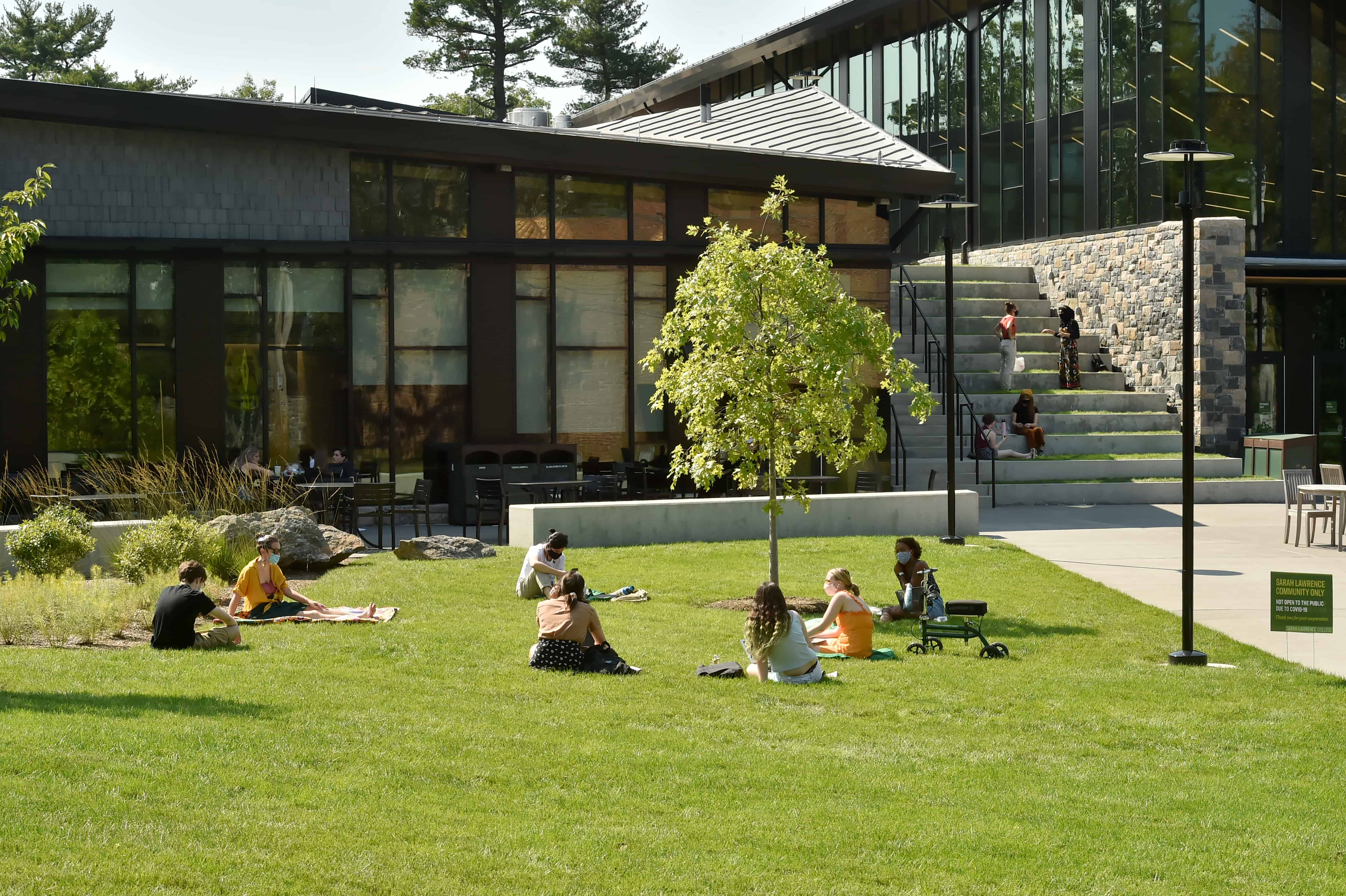 Students socializing on the Campus Center lawn at the start of the fall semester
