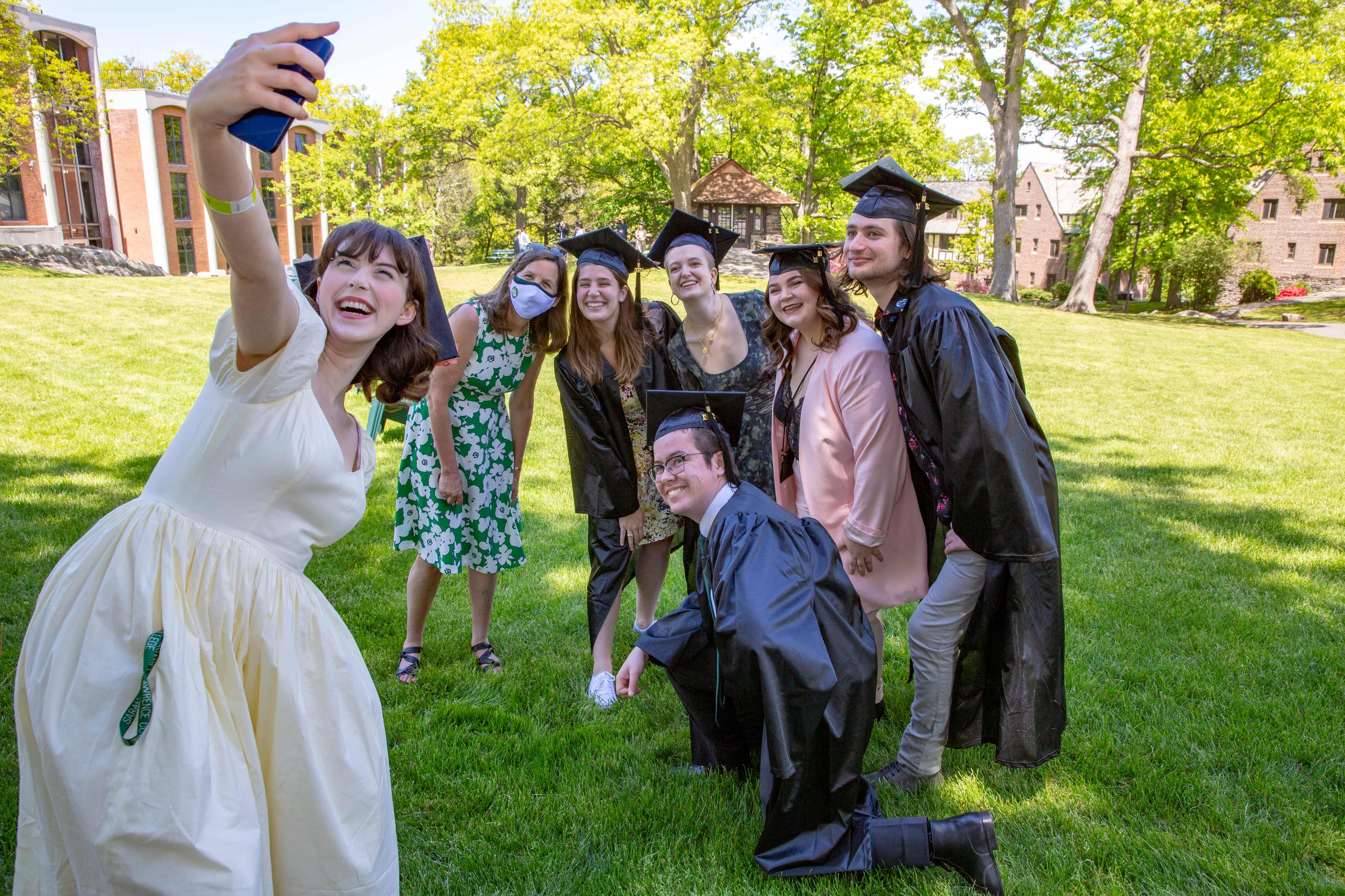 Students snapped selfies during a picnic on Westlands Lawn following the ceremony