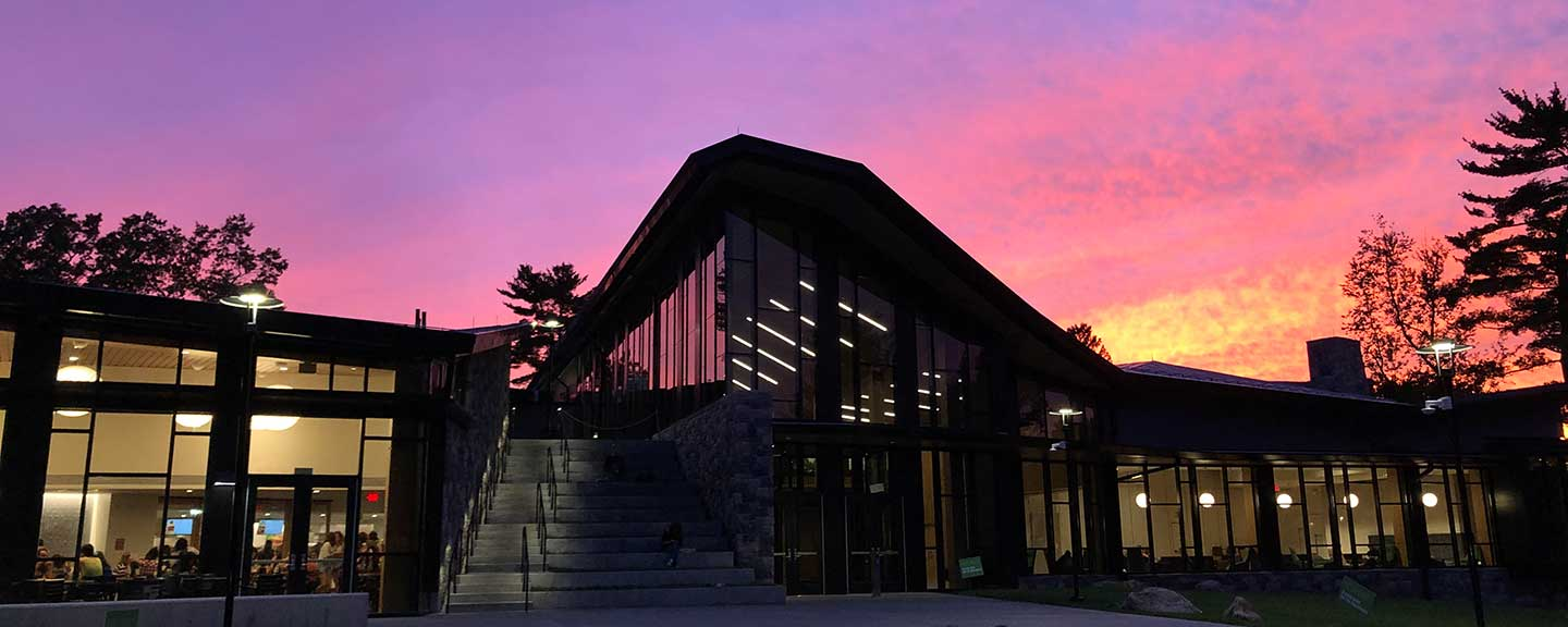 The Barbara Walters Campus Center at sunset