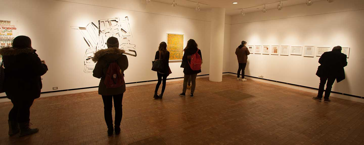 People viewing an exhibit at the Heimbold Gallery