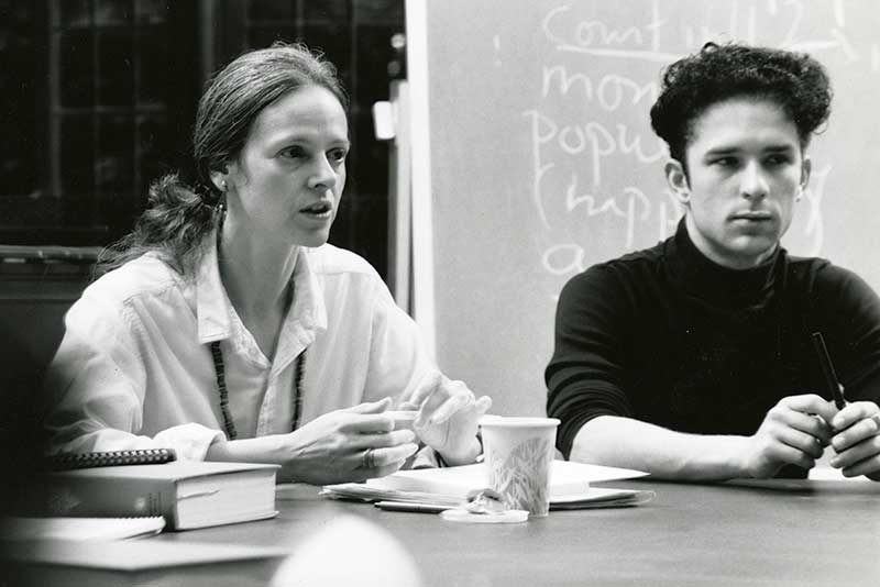 Ann Lauinger in class with a student