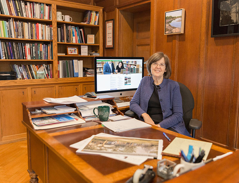 President Cristle Collins Judd at her desk
