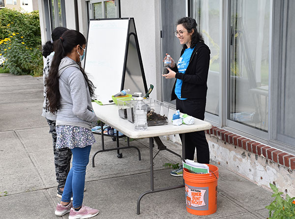 A teacher showing students samples from the Hudson River