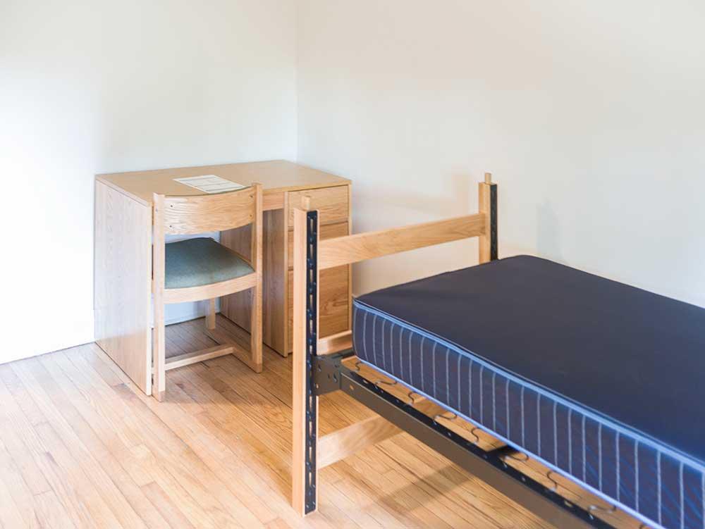 OSilas dorm room with a desk