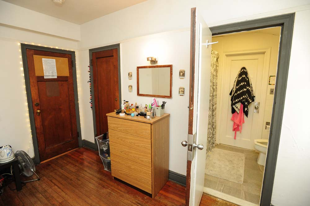 MacCracken dorm room with a bathroom and bureau