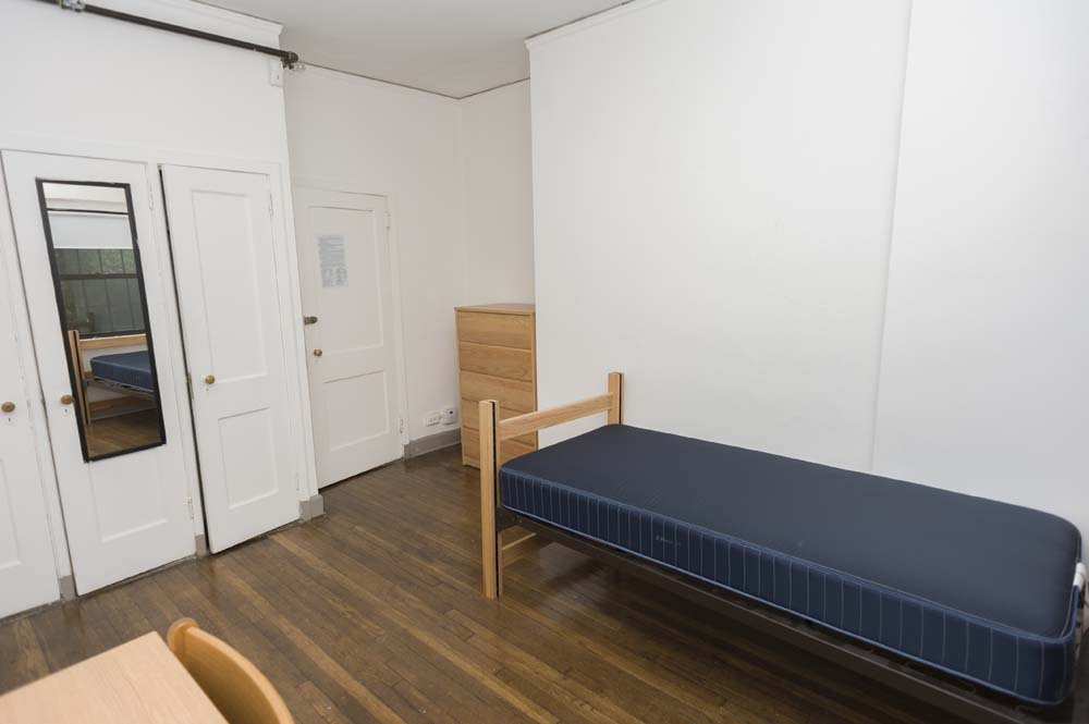 Slonim House dorm room with a bed and a closet