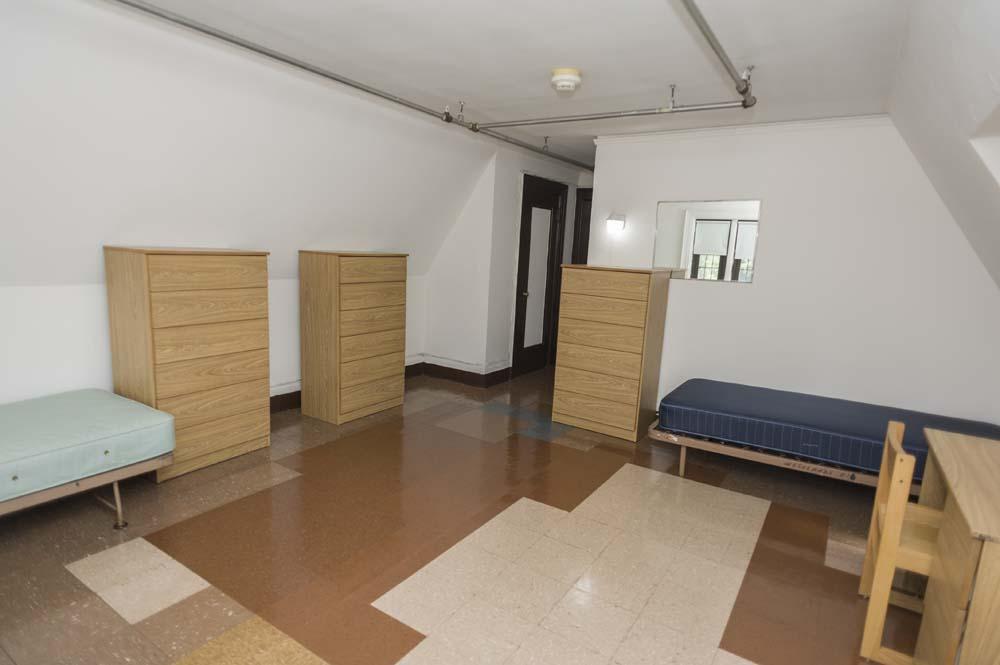 Westlands Hall dorm room with beds and bureaus