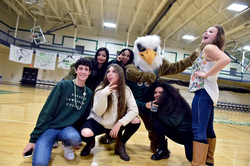 pic of students and the mascot posing at a Homecoming event