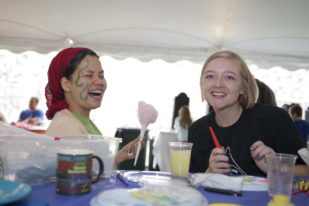 two students during a face-painting at the Mayfair carnival