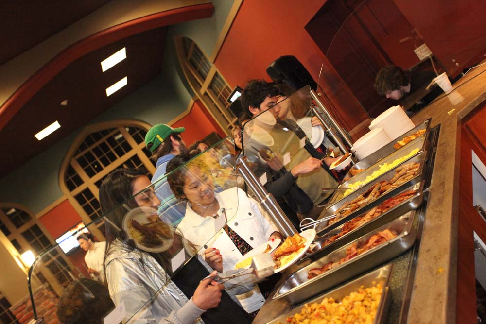 pic of students deciding what to select at the Midnight Breakfast