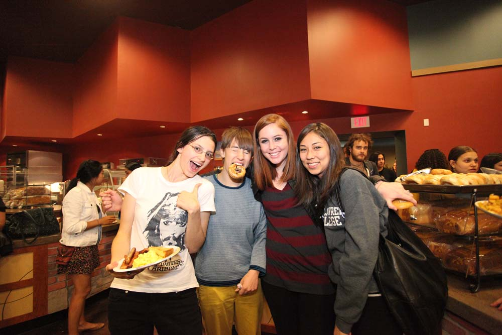 pic of a group of 4 friends enjoying the Midnight Breakfast