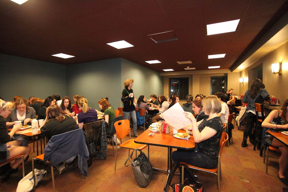pic of students eating in various groups at the Midnight Breakfast