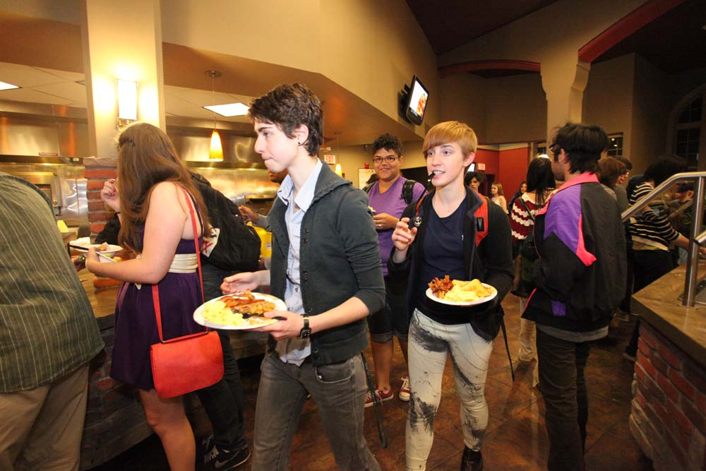 pic of students standing in line for the Midnight Breakfast in Bates Hall
