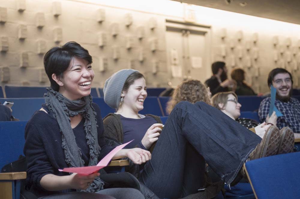 students laughing in a theater at the SSSF fundraising auction