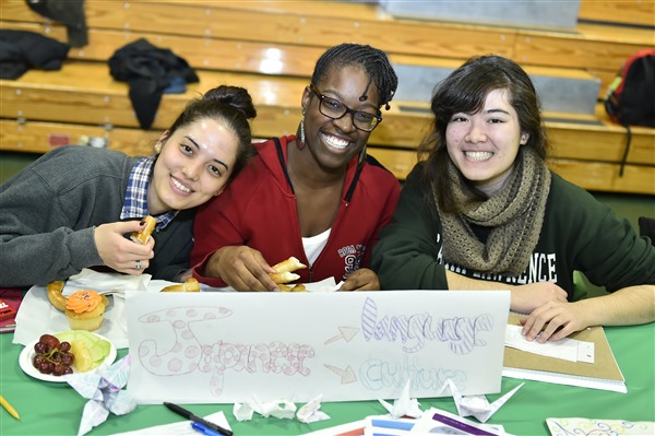 3 students at the annual Student Organization Fair with Japanese language culture interests