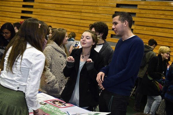 student asking questions at annual Student Organization Fair about reading buddies
