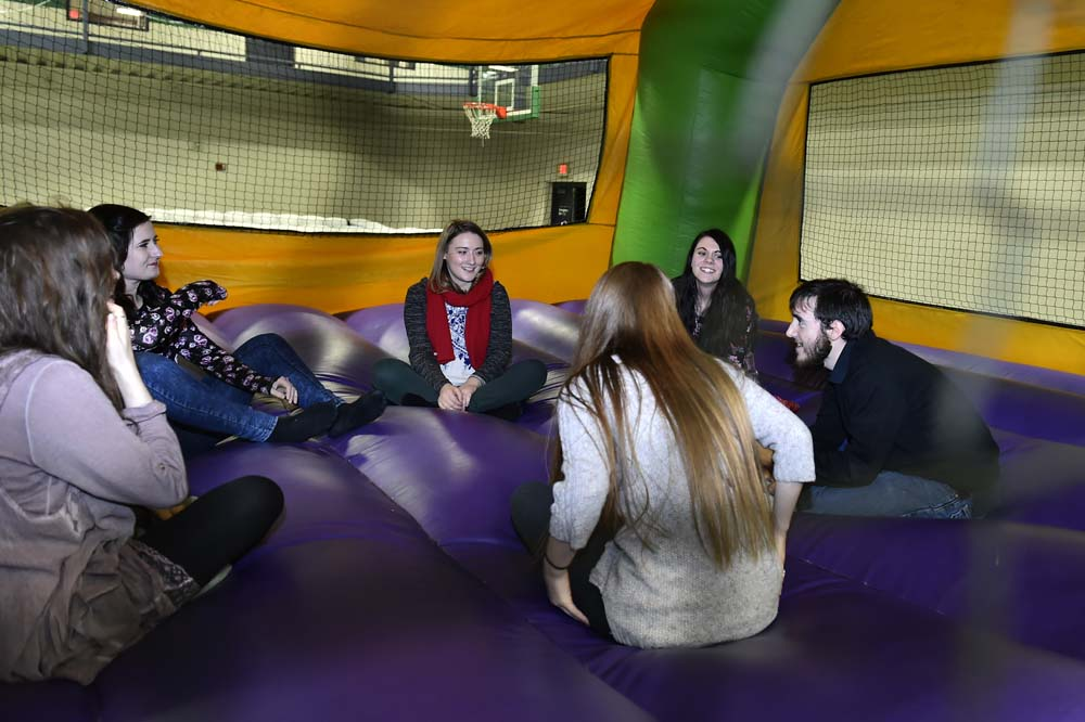 students at the Winter Carnival in an inflatable tent