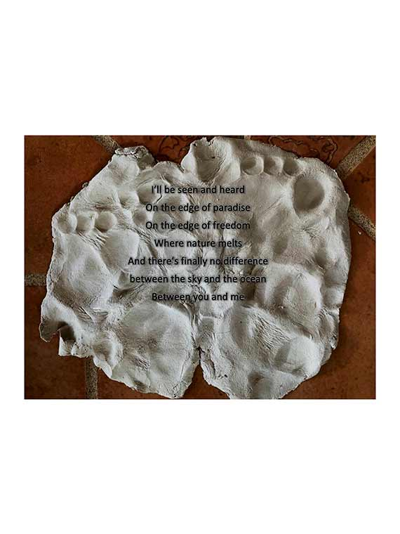 poetry captured along printed ceramic canvas displayed throughout gallery