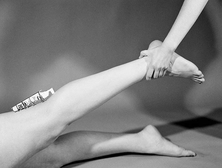 Photograph of hand holding up leg