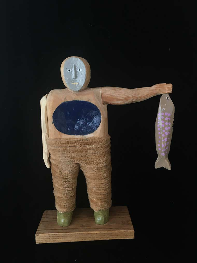 Saaf wood sculpture or man holding fish