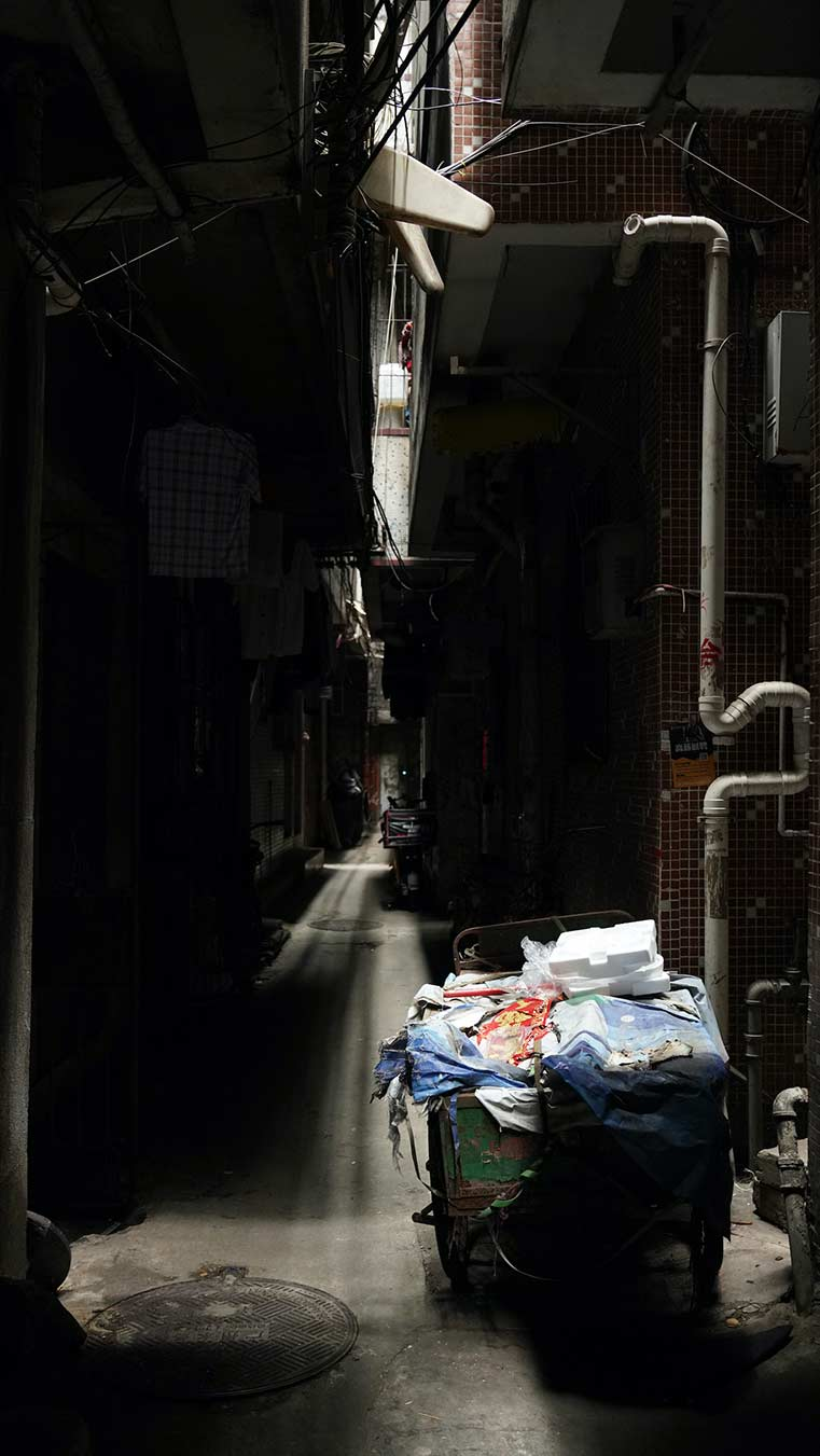 Photograph of alley with collected items